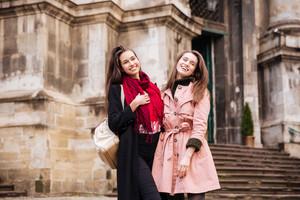 Girls friends in coats. on the street