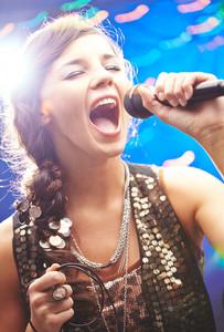 Glamorous girl singing emotional song