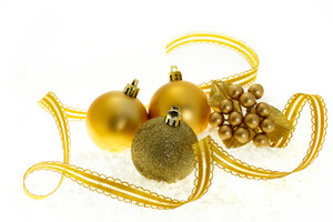Golden Christmas ornaments on white background