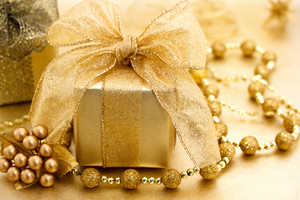 Golden colored image of Christmas gift