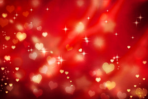 Golden small hearts on red background with stars