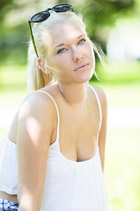 Good looking teenage girl outdoor in park