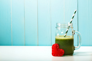 Green vegetable smoothie made with love in a masons jar