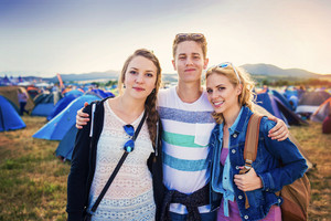 Group of beautiful teens at summer festival