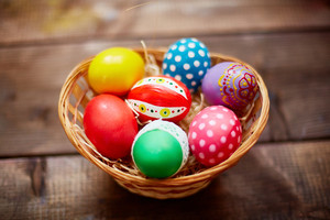 Group of decorative Easter eggs in small basket