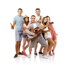Group of happy young people having fun with guitar, isolated on white background. Best friends