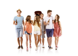 Group of happy young people walking, taking guitar and drinks with them, isolated on white background. Best friends