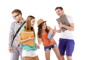 Group of happy young teenager students standing and smiling with books and bags isolated on white background.