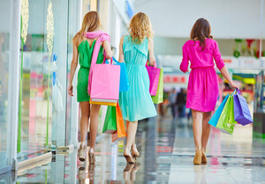 Group of shoppers carrying paperbags