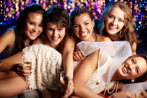 Group shot of young women celebrating their friend's forthcoming marriage, hen party