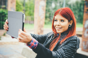 Half length of young beautiful hispanic redhead woman with tablet handhold taking selfie - technology, vanity, social network concept