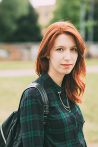Half length of young handsome caucasian redhead straight hair woman looking in camera, serene - carefree, youth concept
