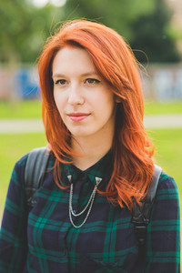 Half length of young handsome caucasian redhead straight hair woman overlooking smiling, wearing checked blue and green shirt - youth, carefree concept