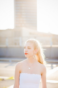 Half length portrait of young handsome caucasian long blonde straight hair woman overlooking right, serene - carefreeness, youth, thinking future concept - backlight