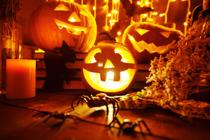 Halloween composition of pumpkins and candles