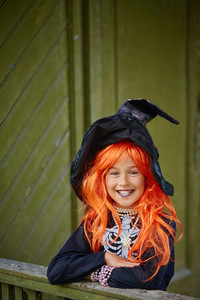 Halloween girl in special attire looking at camera with smile