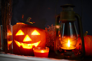 Halloween pumpkin, lantern and burning candle