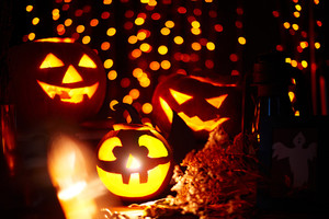 Halloween pumpkins with burning candles inside