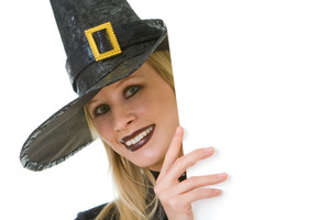 Halloween witch looking out of board with your advert