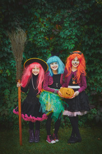 Halloween witches with pumpkin and broom asking for treat