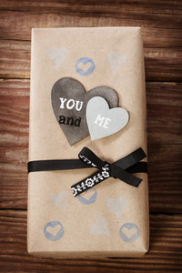 Hand crafted love appreciation present box on rustic wooden table