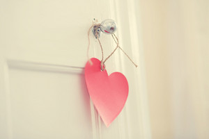Hand crafted red heart hanging from door knob