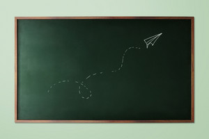hand-drawn paper plane fly on chalkboard background