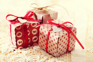 Hand made present boxes with red ribbons and heart shaped tags