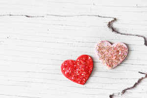 Handcraft pink and red hearts with glitter