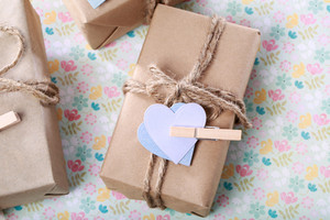 Handmade gift box with purple and blue hearts in rustic style