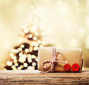Handmade gift box with star shaped lights on Christmas tree