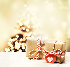 Handmade gift boxes with star shaped lights on Christmas tree