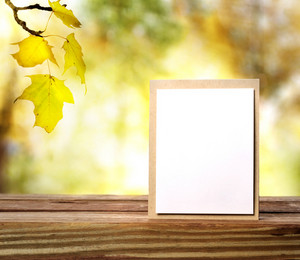 Handmade greeting card on shinning fall background