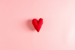 Handmade heart cushion on a pink background