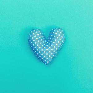 Handmade heart cushions on a blue background