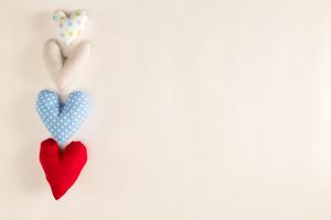 Handmade heart cushions on a white background