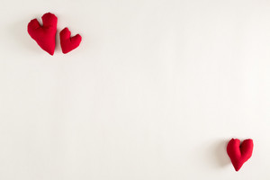 Handmade heart cushions on a white background