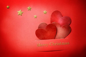 Handmade paper craft Christmas hearts with Merry Christmas text and stars