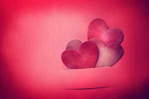 Handmade paper craft Valentine hearts in magenta color