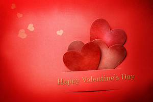 Handmade paper craft Valentine hearts with Happy Valentines Day text and small hearts