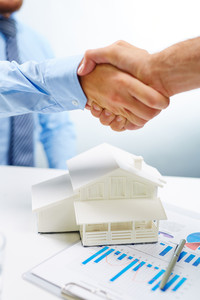 Handshake of buyer and vendor of real estate