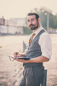 handsome big moustache hipster man in the city