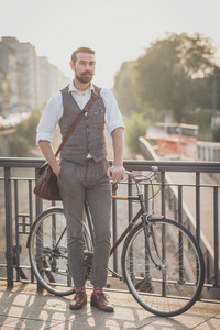 handsome big moustache hipster man with bicycle in the city