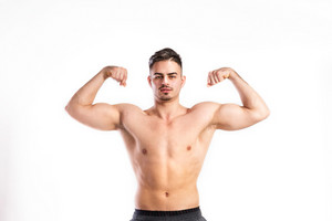 Handsome fitness man with bare chest flexing his arms. Studio shot on white background.