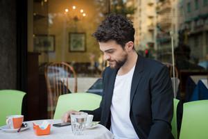 handsome hipster modern man at the cafe