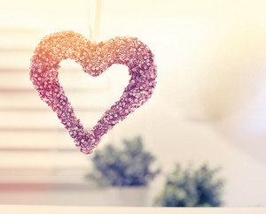 Hanging decorative heart in a bright interior room