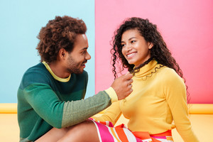 Happy african american young couple smiling and talking