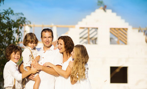 Happy and big family builds a new house for living