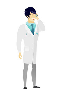 Happy asian doctor in medical gown talking on a mobile phone. Smiling doctor talking on cell phone. Young doctor with mobile phone. Vector flat design illustration isolated on white background.