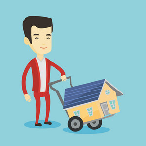 Happy asian man pushing a shopping trolley with a house. Young smiling man buying new house. Man using shopping trolley to transport a small house. Vector flat design illustration. Square layout.